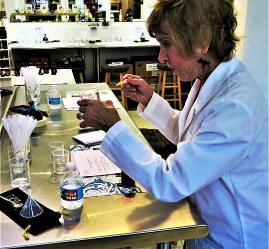 writer creating perfume from scratch at The Parfumerie