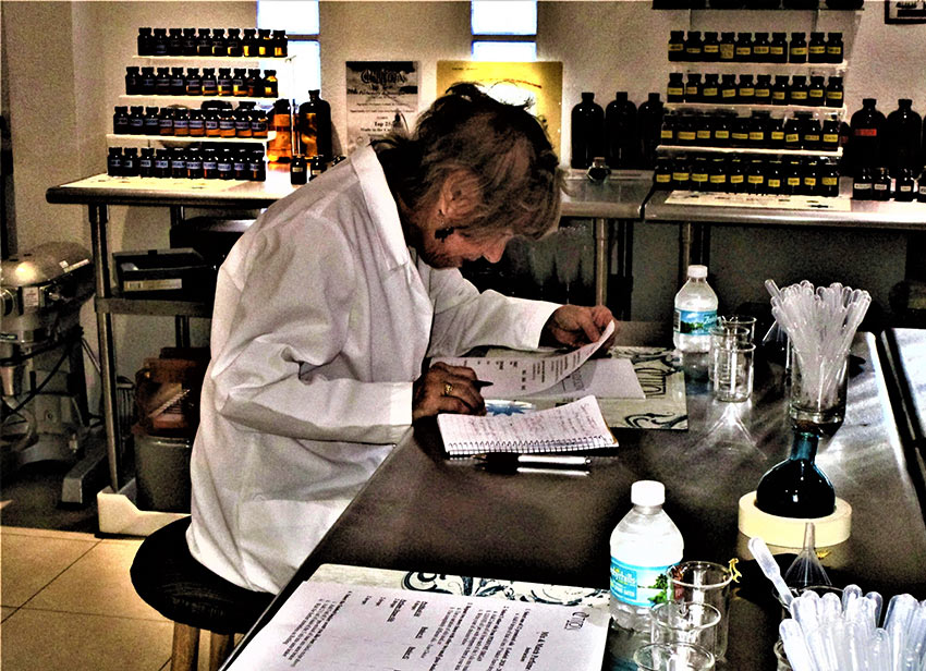 writer in lab coat at The Parfumerie, St. Martin