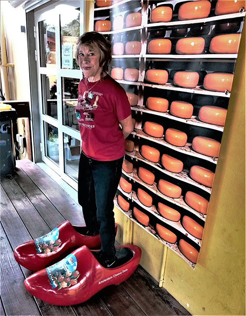 writer in giant clogs, Amsterdam Cheese and Liquor Store, St. Maarten