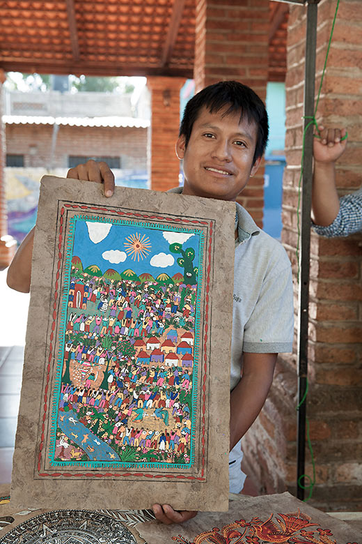 local painter Marco and one of his paintings in San Pancho