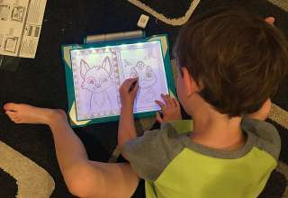 kid with Crayola Light Up Tracing Pad