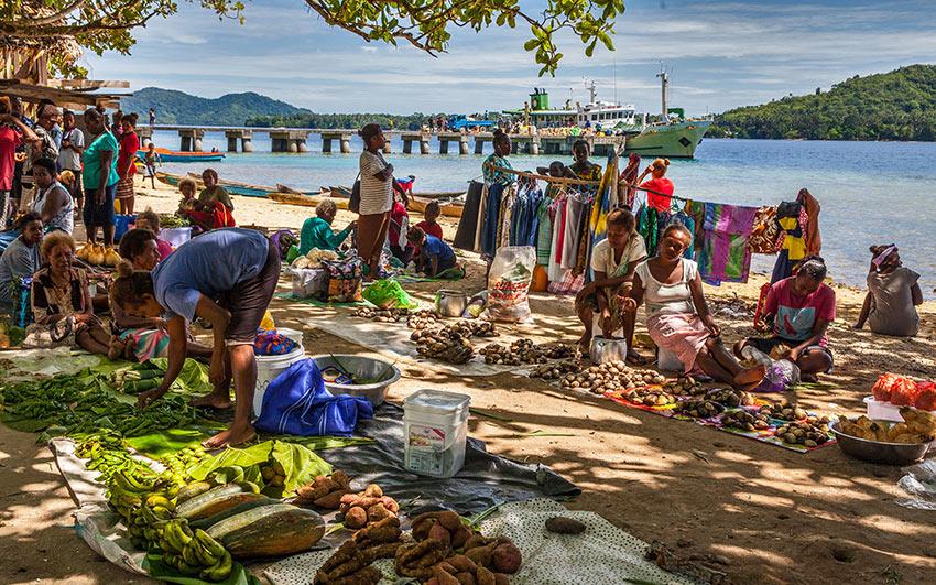 locals at a market near a pier
