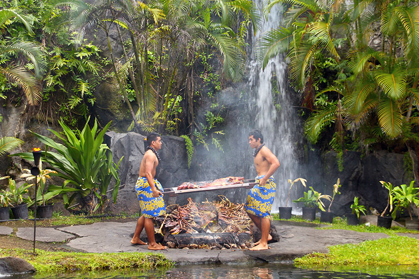 cooking Kalua Pig in an imU underground oven