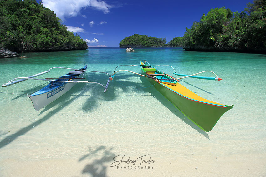 outrigger boats along the beach at Babas Cove
