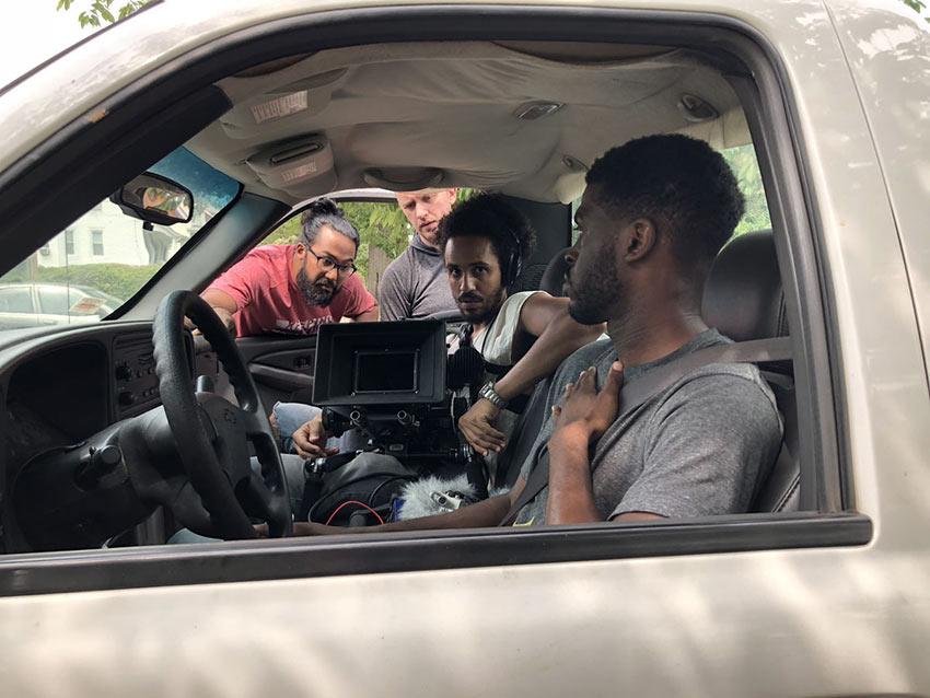 Merawi Gerima (filmmaker) unidentified crew member, Mark Jeevaratnam (cinematographer) and Obinna Nwachukwu