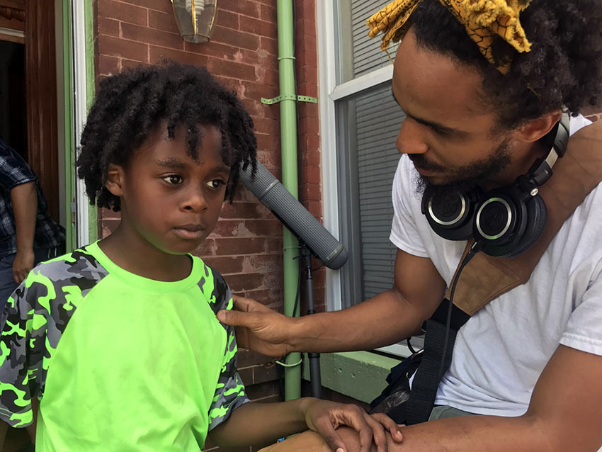 """Jacari Dye as the """"Young Jay"""" taking direction from filmmaker Merawi Gerima"""