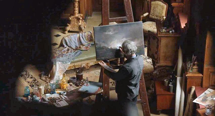 Han Van Meegeren (Guy Pierce) at work in his studio