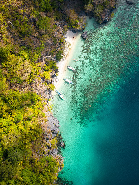drone shot of Hidden Beach, Matinloc Island, El Nido