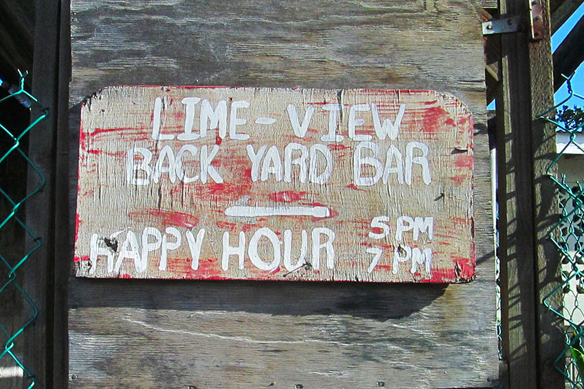 rum shop sign on a beach, Nevis Island