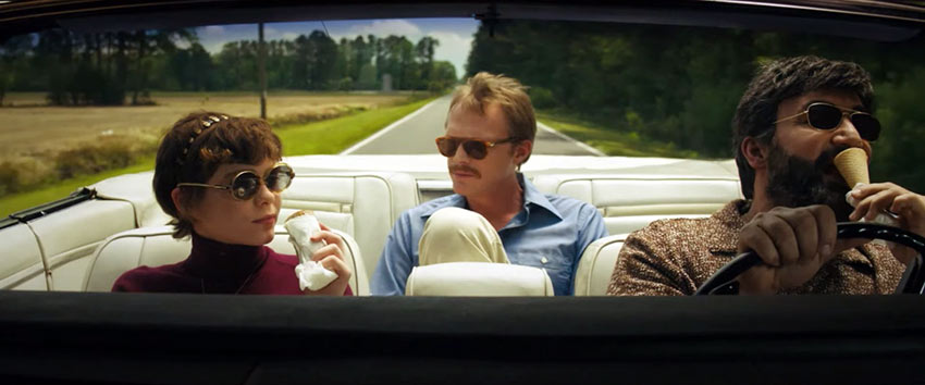 Beth (Sophia Lillis,) Uncle Frank (Paul Bettany) and Wally (Peter Macdiss) in a road trip scene