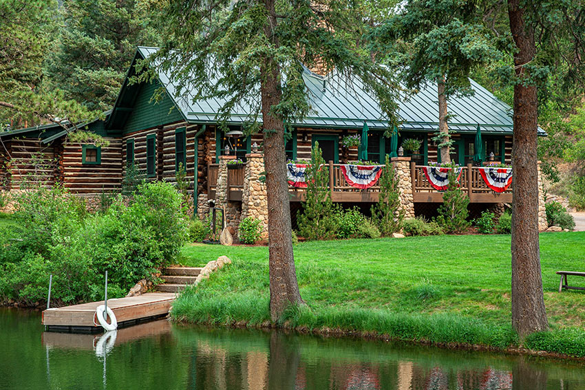 decorative flags at the log cabin at Emerald Valley Ranch