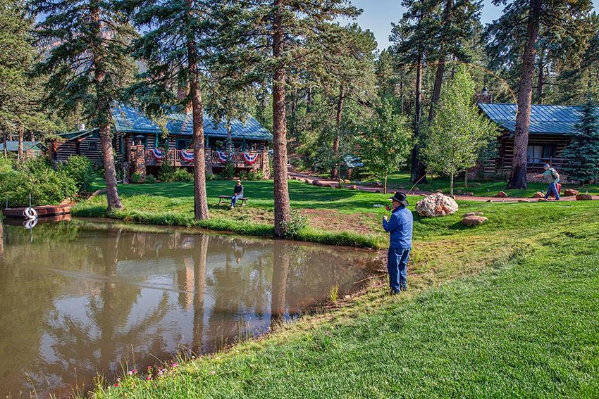 anglers at a small lake