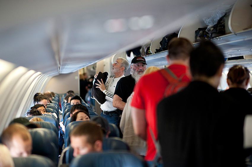 passengers board a packed Delta Air Lines aircraft