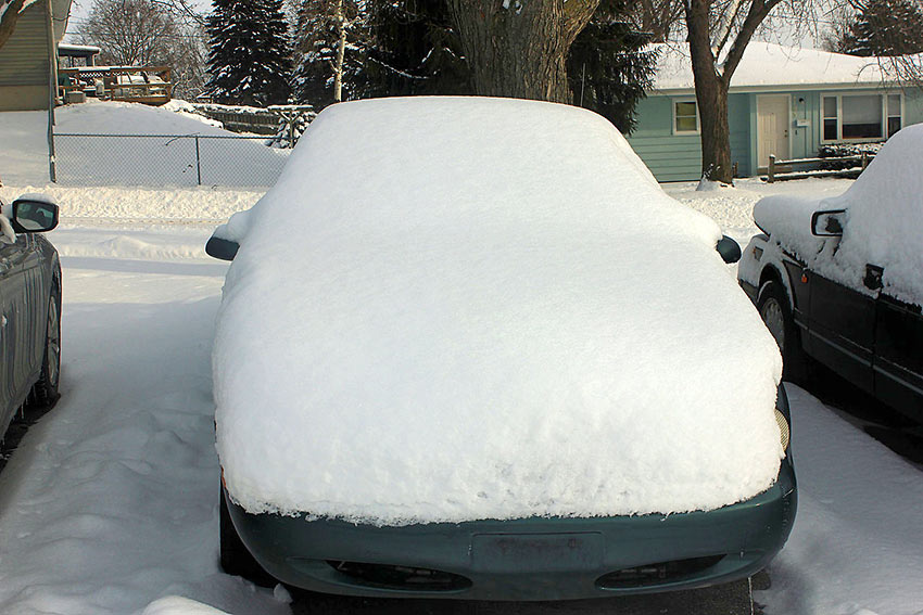 snow-covered car in Maine